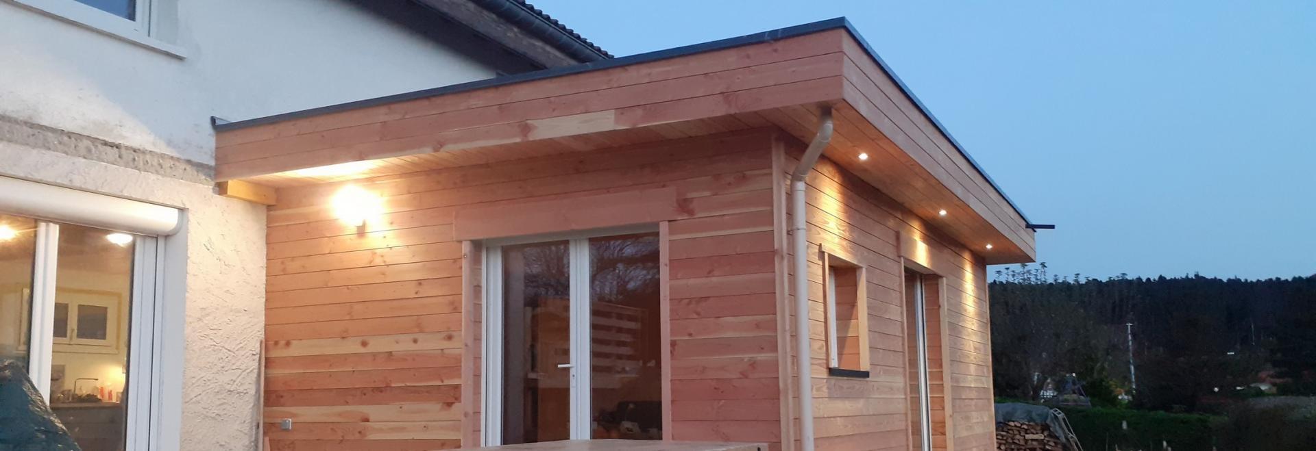 extension d'habitation avec débords de toit